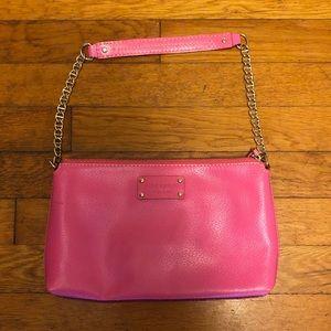 Bright pink Kate Spade clutch